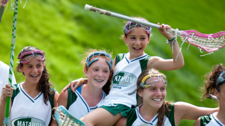 girls celebrating after a lacrosse game