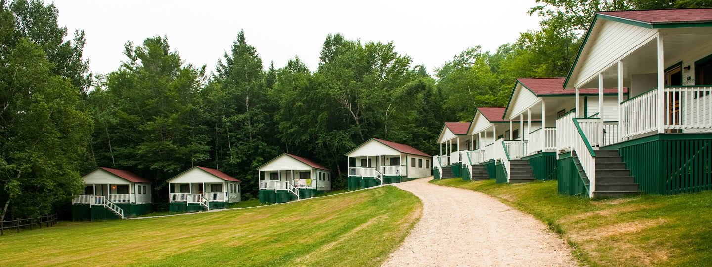 A distant view of the bunk cabins at Camp Mataponi