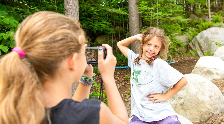 a girl posing while another girl takes her picture