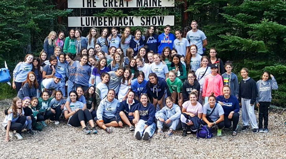 Group of Mataponi campers pose in front of Maine Lumberjack Show sign