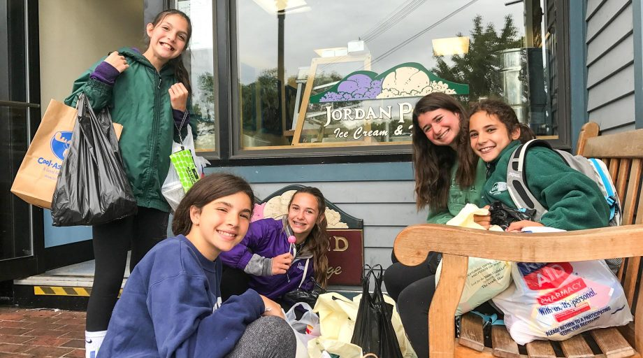Mataponi campers gather in front of Bar Harbor storefront