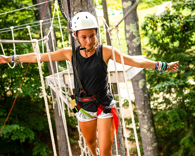 a girl on a ropes course