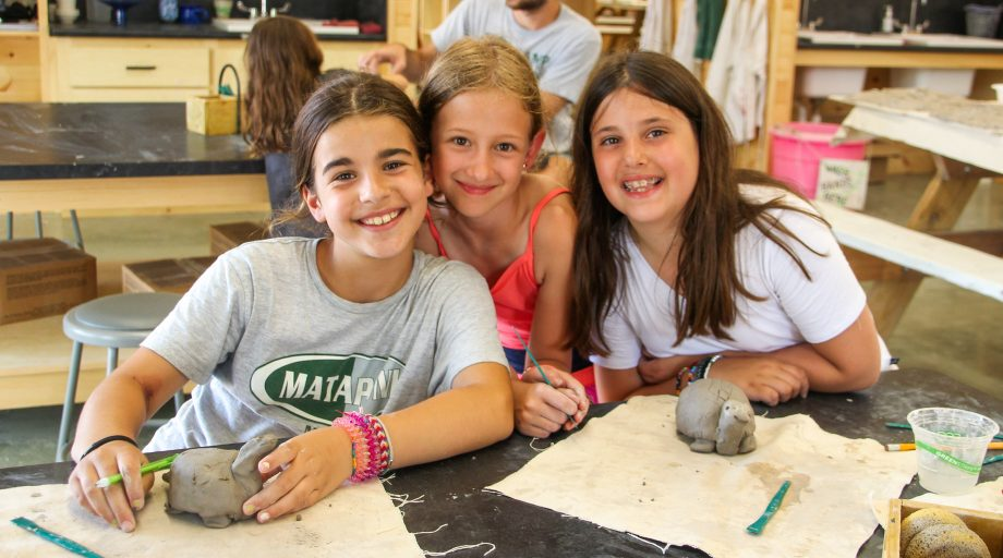 a group of girls working on ceramics