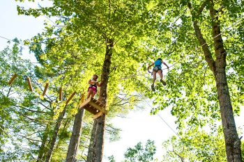 girl traversing ropes course