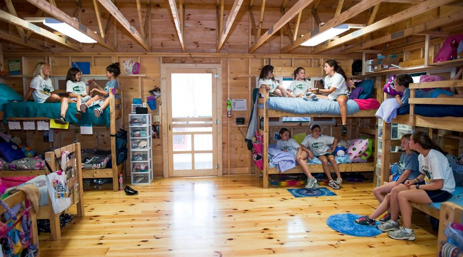 girls hangng out in their cabin at Camp Mataponi