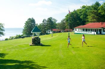 girls running on the lawn at Camp Mataponi