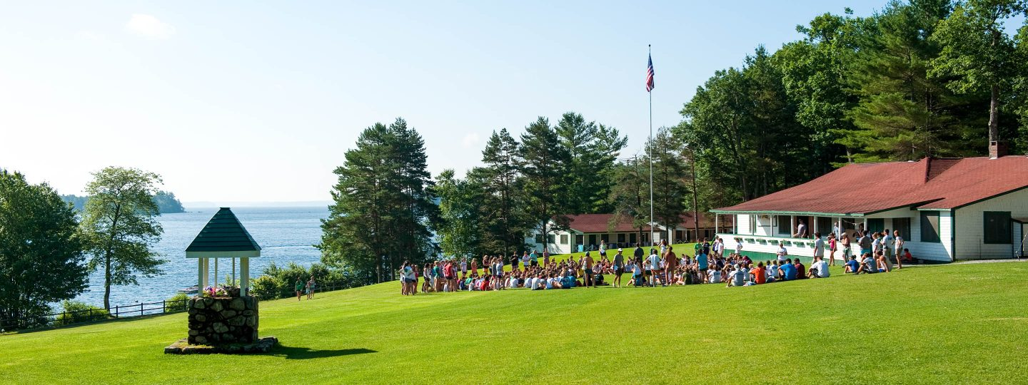 a group gathering on the lawn at Camp Mataponi