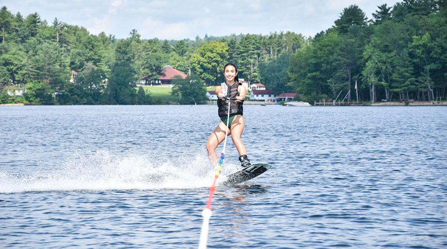 Girl wakeboarding at summer camp