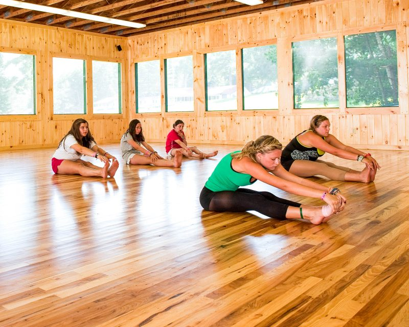 girls stretching in yoga class