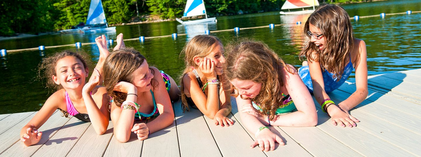 girls hanging out on a dock on Sebago Lake