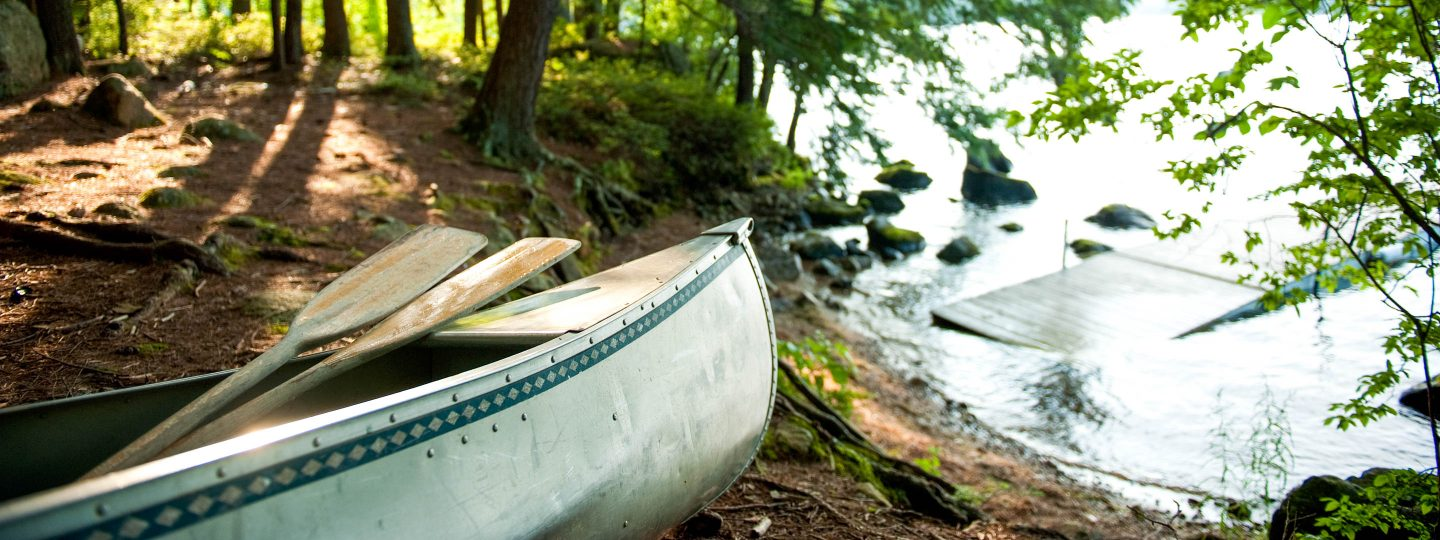 a canoe on the shore of Sebago Lake