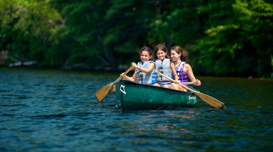 three girls in a canoe on Sebago Lake