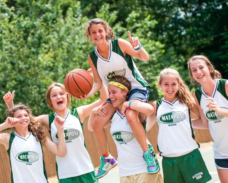 Girls celebrating on the basketball court