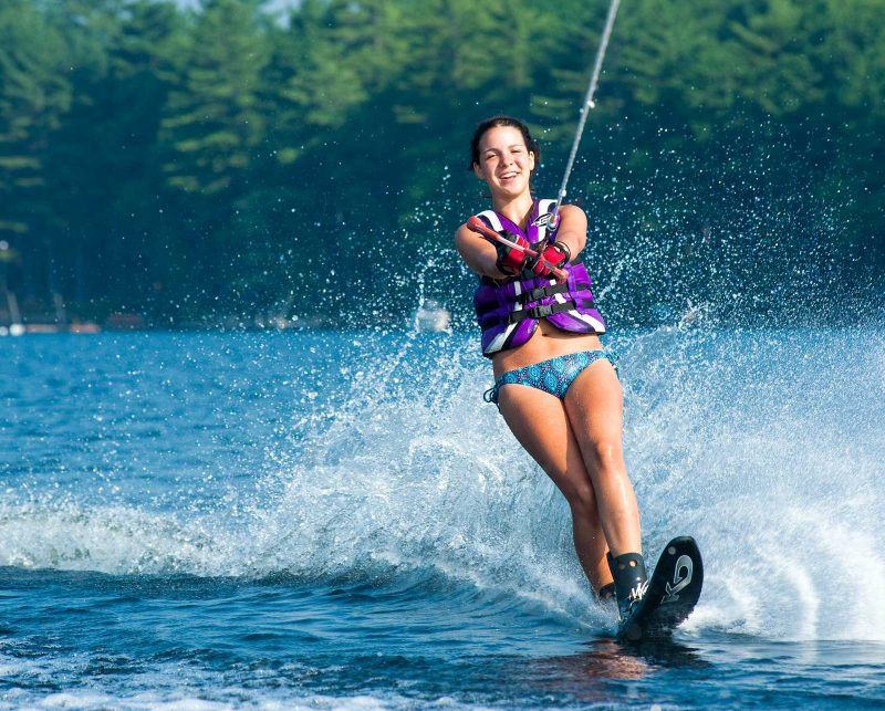 a girl smiling while water skiing