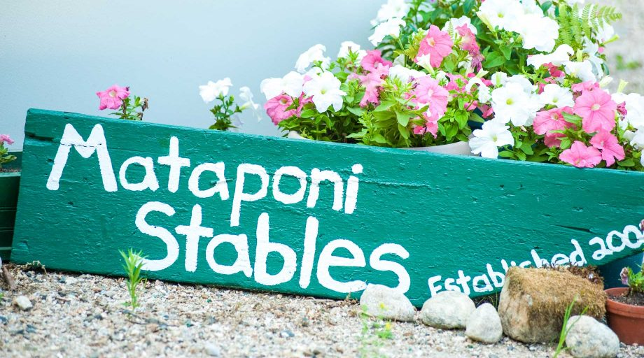a sign for the Camp Mataponi stables