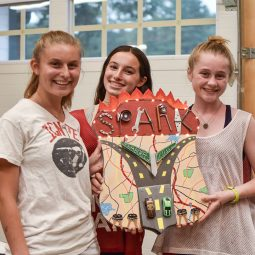 girls holding up an arts & crafts creation