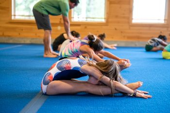 girls stretching in gymnastics class