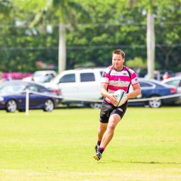 Justin Philpot playing rugby