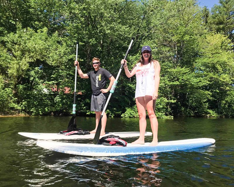 Mataponi staff members on stand-up paddleboards
