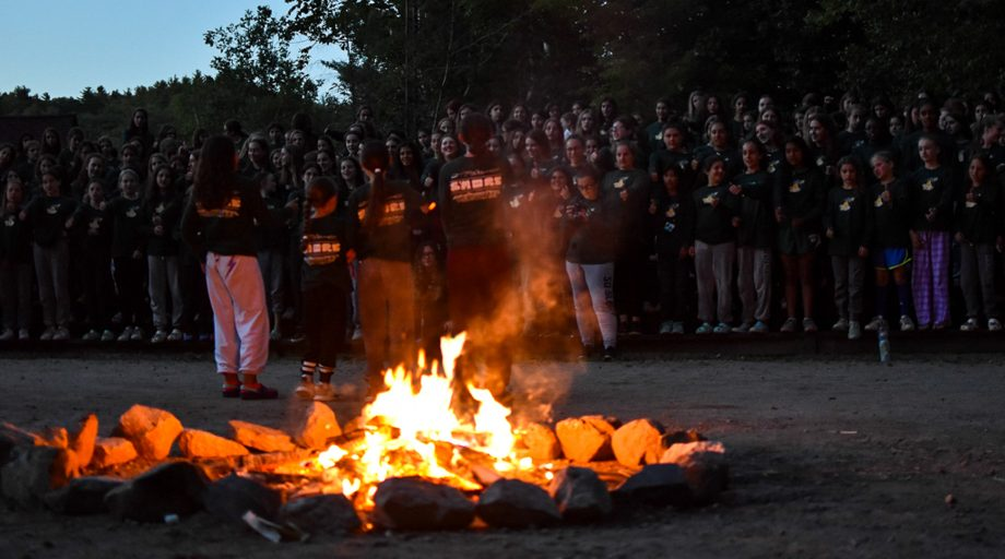 View past campfire of senior campers gathering