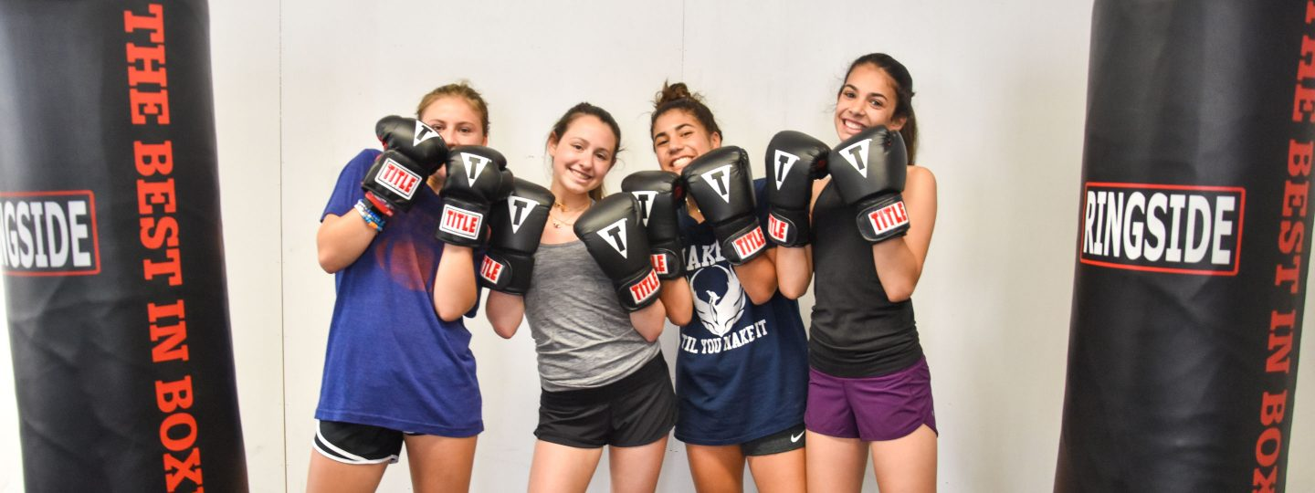 girl campers posing in boxing class
