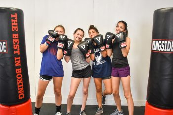 campers posing with boxing gloves