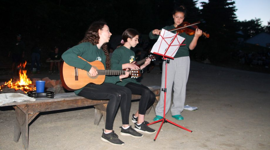 campers playing music together