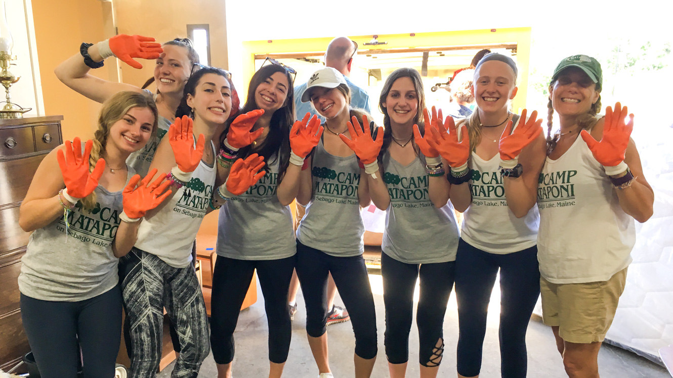 Group of Mataponi campers wearing orange work gloves