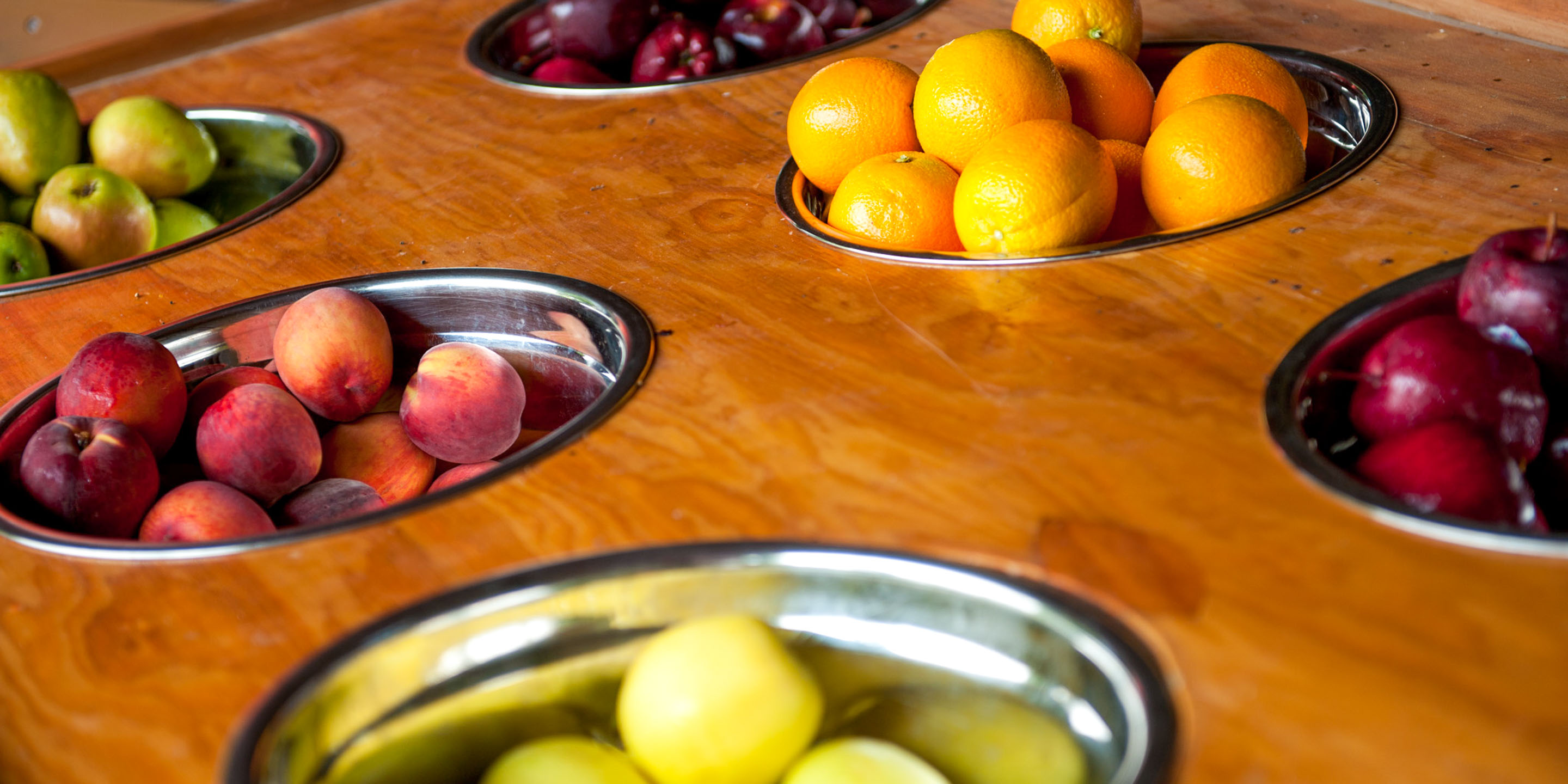 Low angle of fresh fruit in metal bowls