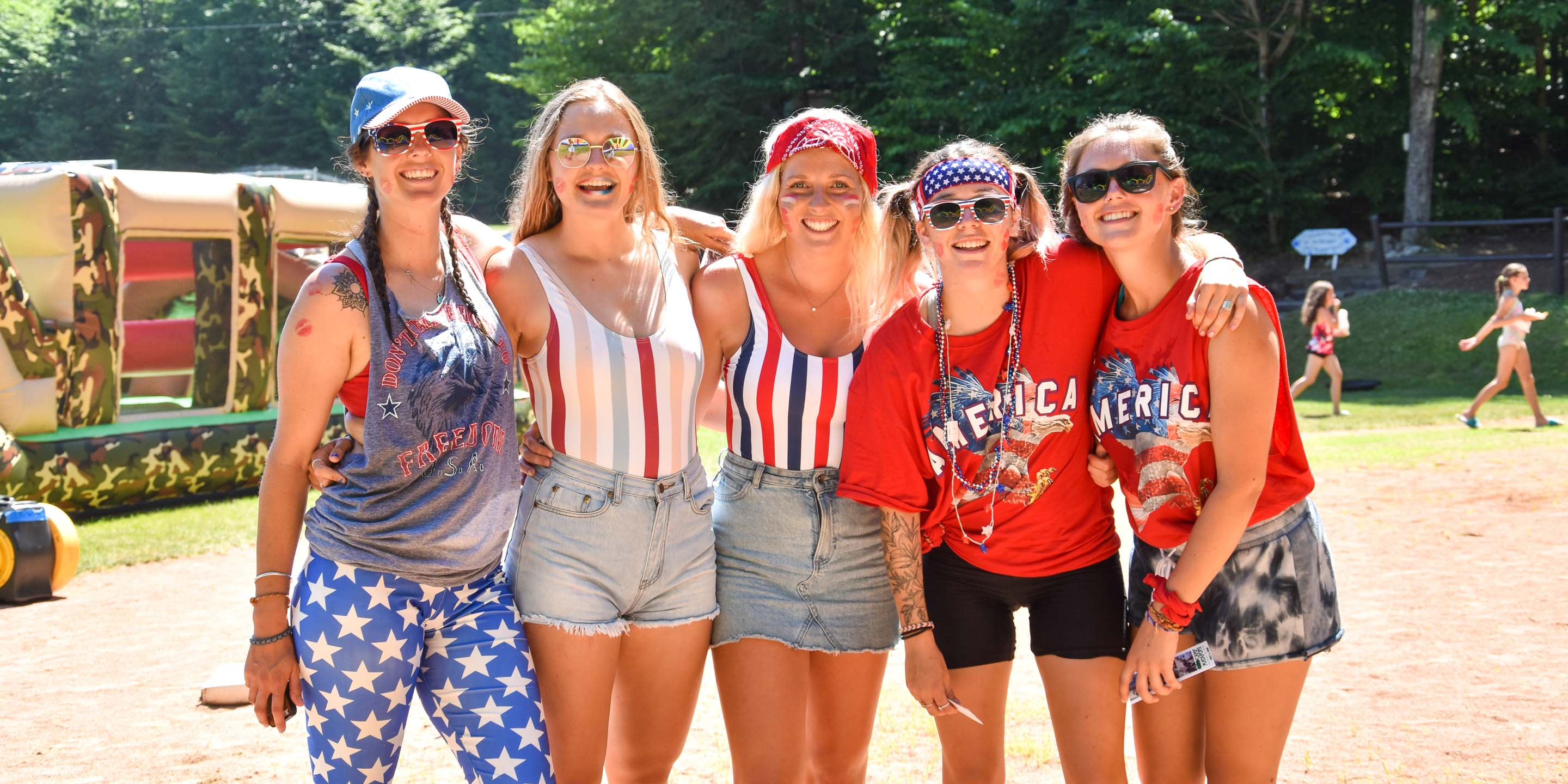 Counselors dressed up in red, white and blue for 4th of July