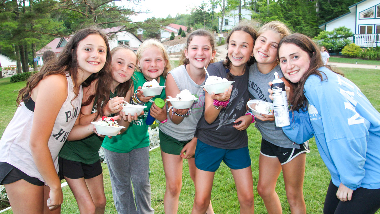Group of campers holding ice cream sundaes